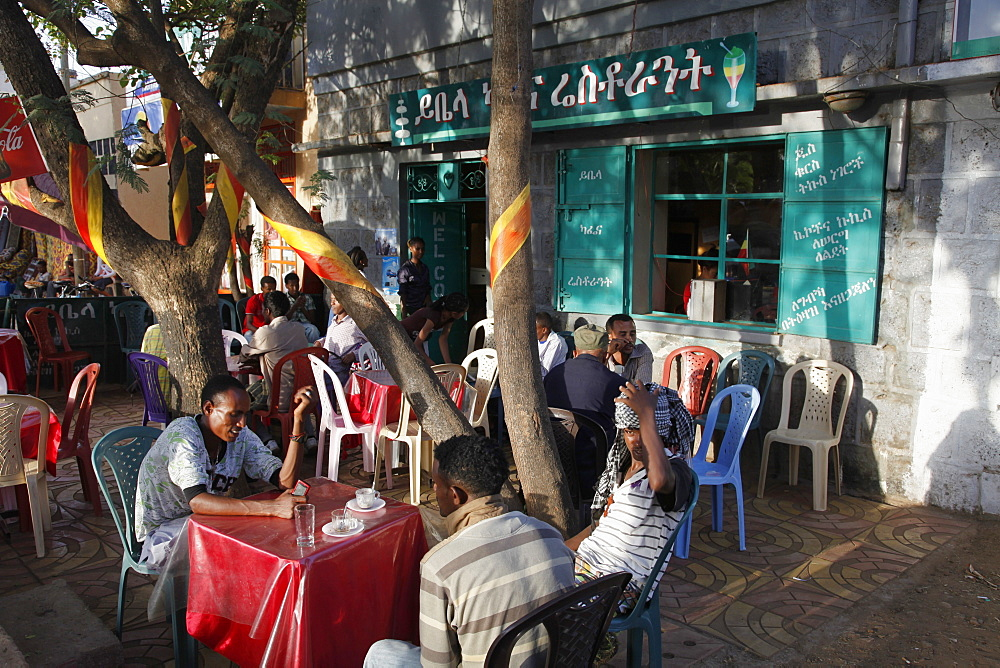 People talking and sitting in cafes in Bahir Dar, Ethiopia, Africa