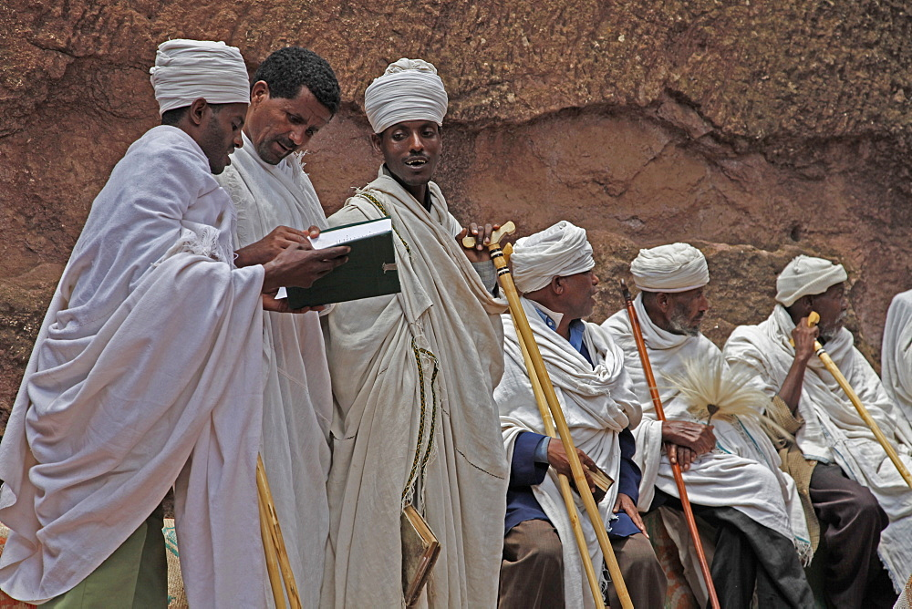 Priests singing during Easter Orthodox Christian religious celebrations in the ancient rock-hewn churches of Lalibela, Ethiopia, Africa