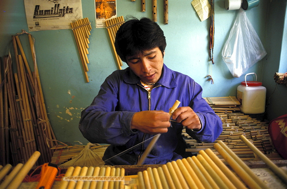 Musical instrument workshop, bolivia. La paz. The man is making traditional pan pipes