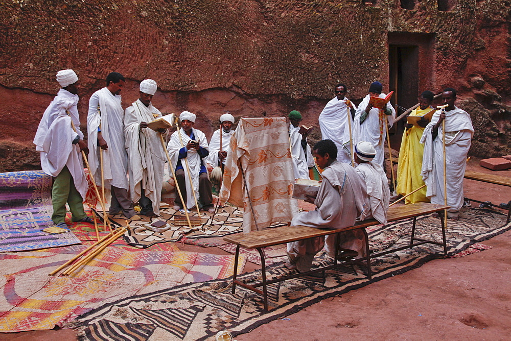 Priests singing during Easter Orthodox Christian religious celebrations in the ancient rock-hewn churches of Lalibela, Ethiopia, Africa - 1188-801