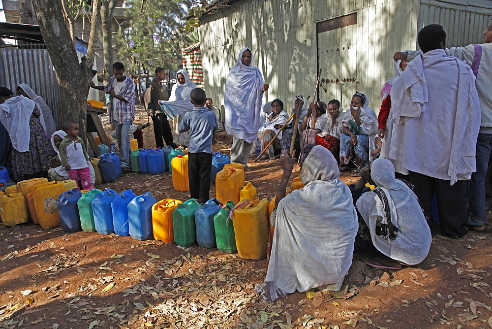 Women queue for water with plastic cans in the outskirts of Addis Ababa, Ethiopia, Africa