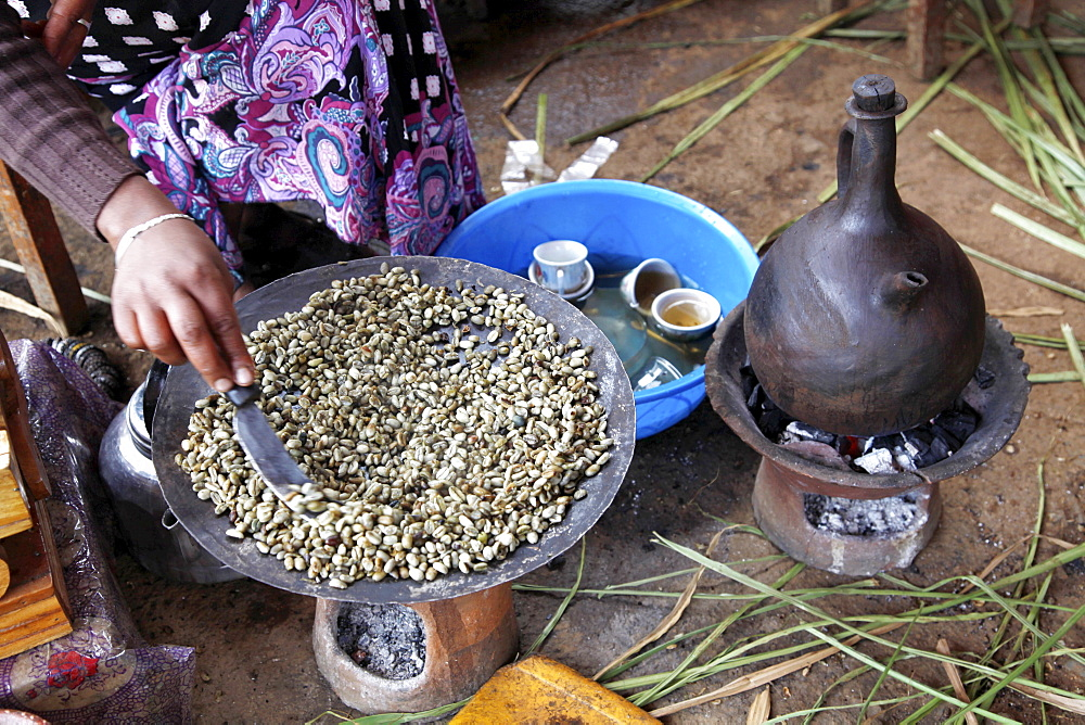 Woman roasting coffee in the Jimma region in Ethiopia, Africa