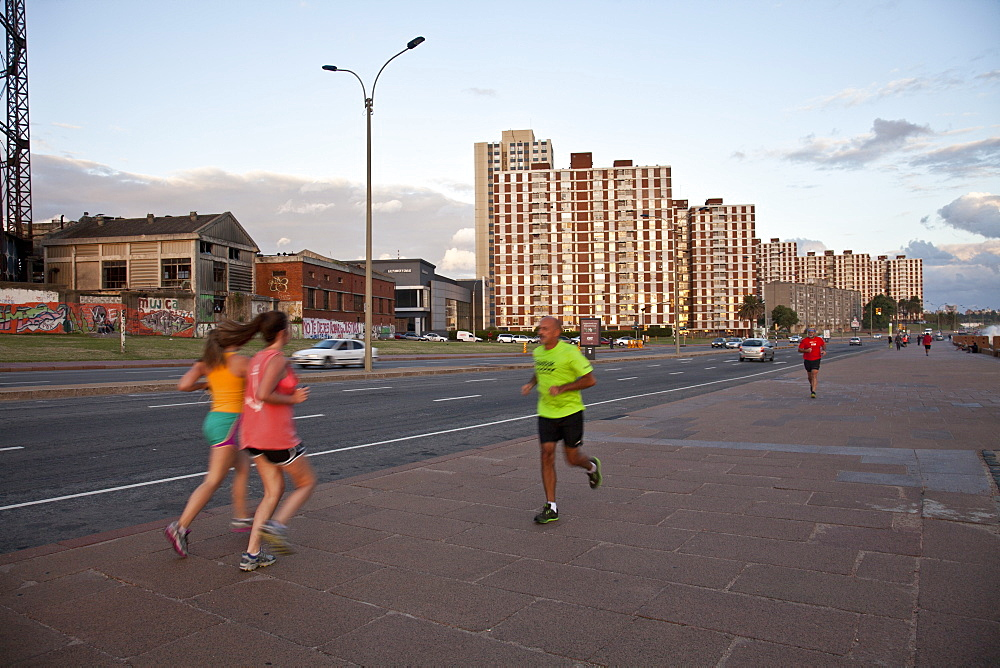 People exercising along the coastal road in Montevideo, Uruguay, South America