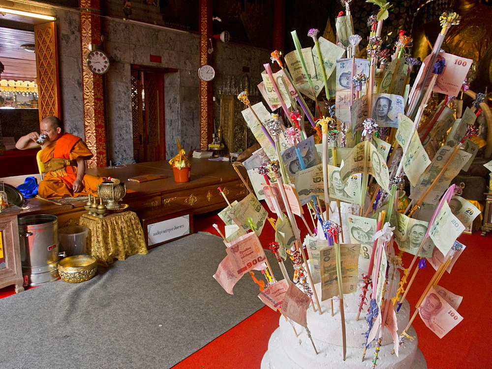 Monk and money gifts in the Wat Phra That Doi Suthep Buddhist temple in Chiang Mai, Thailand, Southeast Asia, Asia - 1188-843
