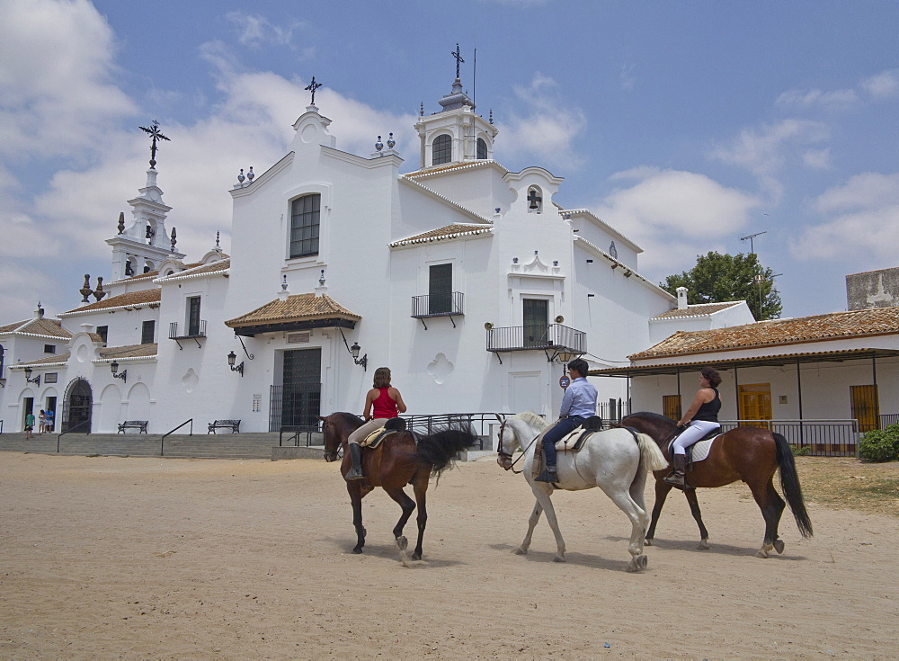 Horse-riding in the village of El Rocio, centre of religious pilgrimage in Andalucia, Spain, Europe