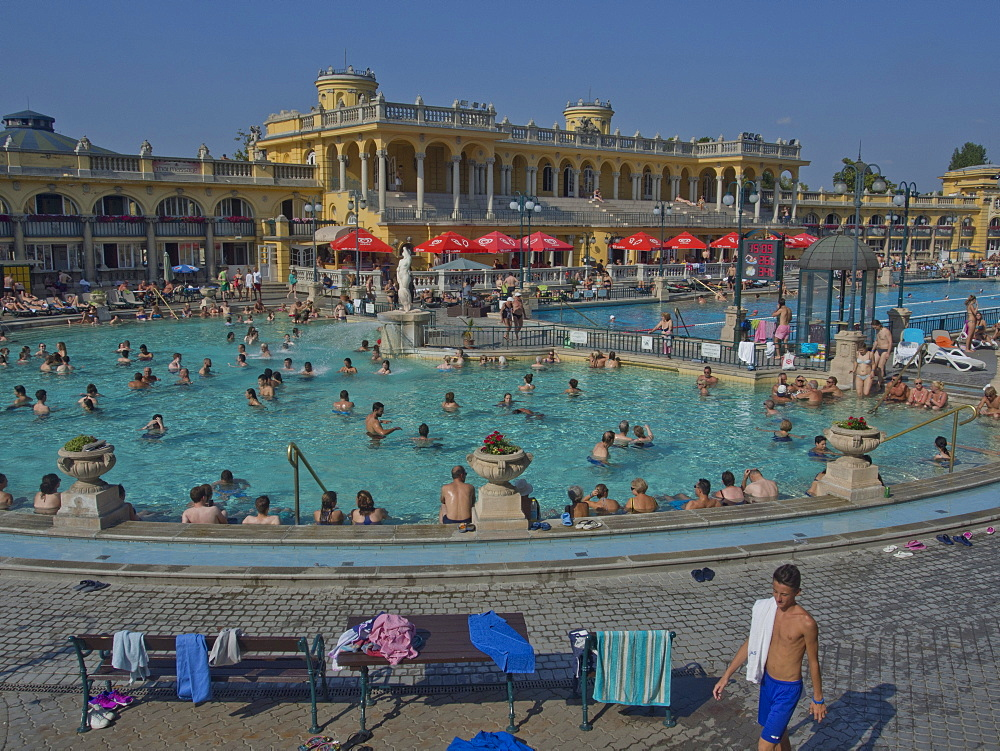 People enjoy the outdoor pools at the Szechenyi Thermal Baths, Budapest, Hungary, Europe - 1188-864
