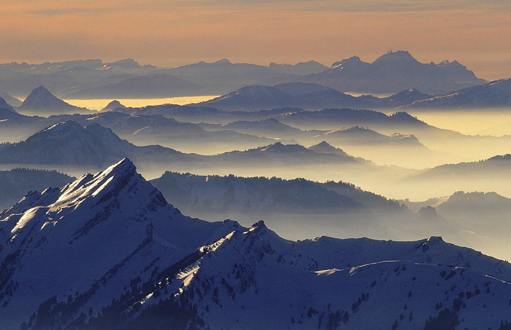 Mountains, switzerland. View from mt. Saentis; mt. Stoss, swiss alps.Evening Light/snow/winter. Saentis, appenzell, eastern part of switzerland. this image is blocked for any calendar use for the year 2006.