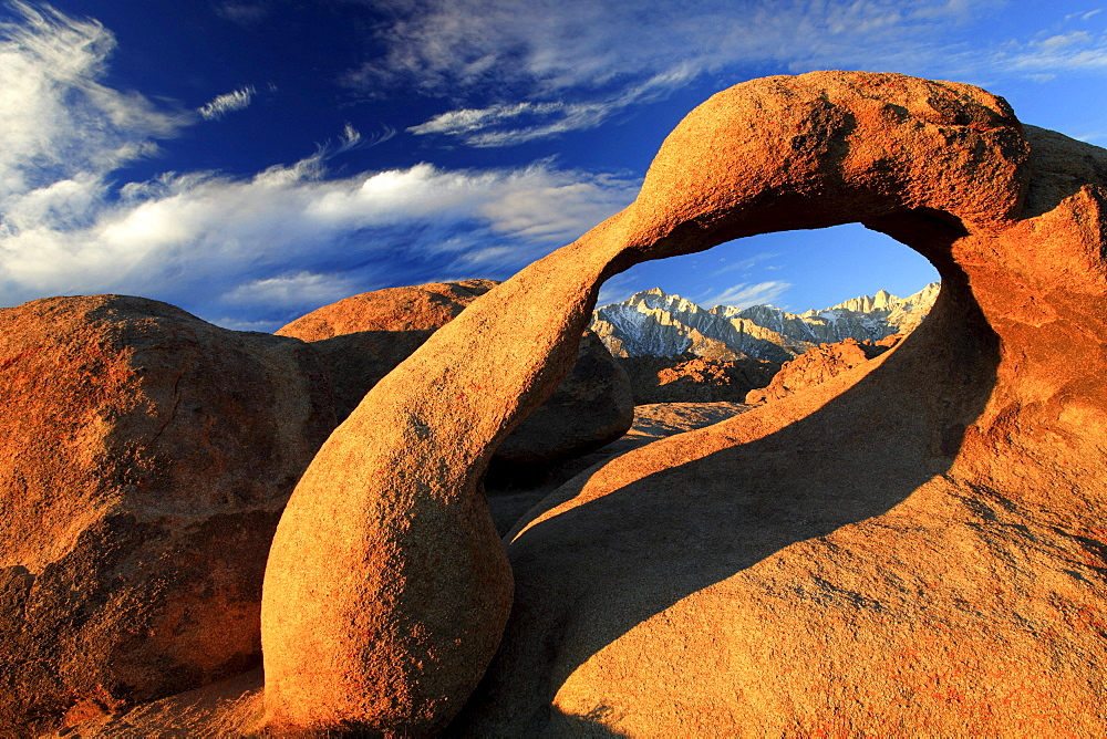 Mobius arch, natural arch formed out of granit rock at sunrise, lone pine peak, 12994, feet, mt. whitney, 14497, feet, highest peak of lower 48, alabama hills, sierra nevada, lone pine, california, usa