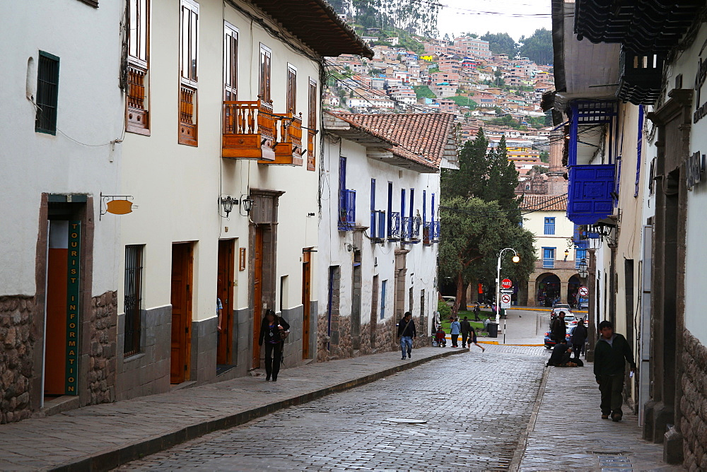 Side street in centre of Cusco City with outskirts of city on hill beyond, Cuzco, Peru, South America