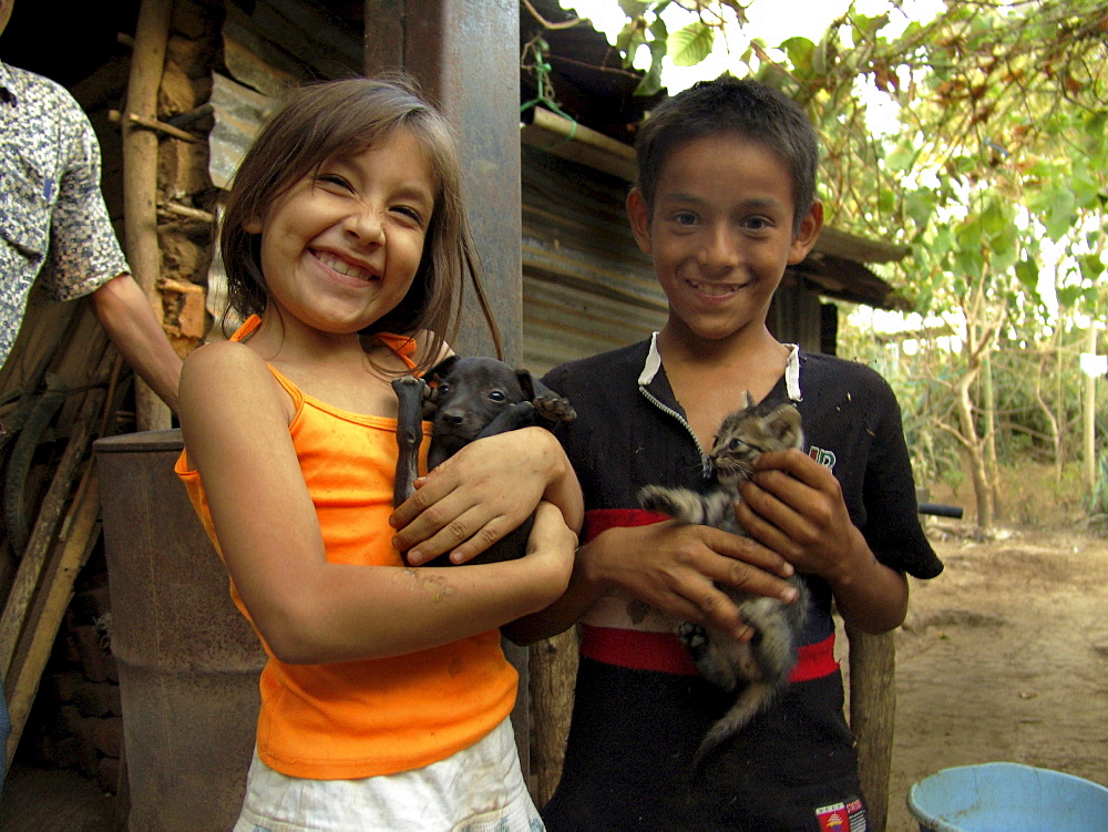 El salvador brother & sister with puppy and kitten, san francsisco javier