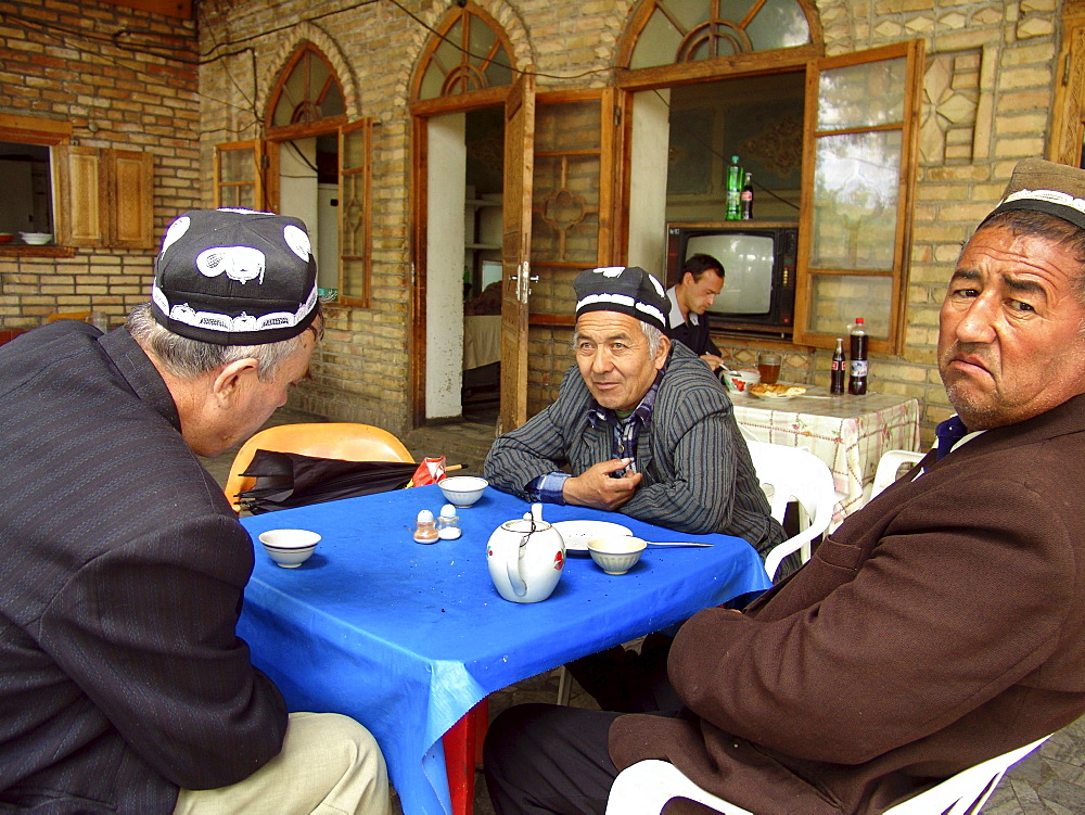 Uzbekistan men drinking tea at a chaikhana, shakhrisabz.