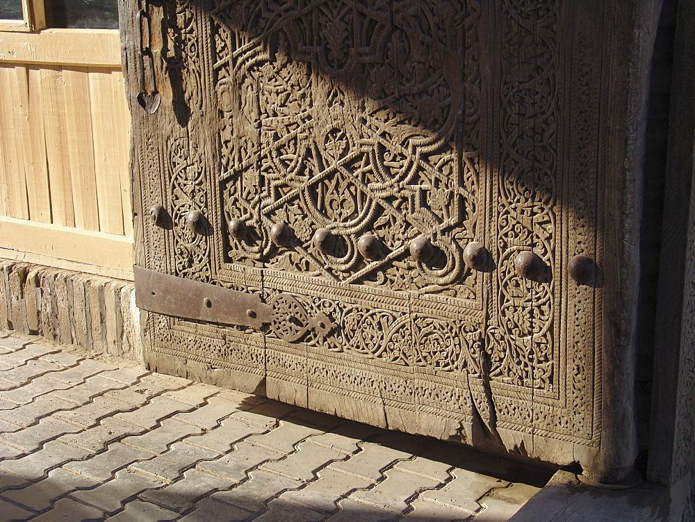 Uzbekistan detail of old door to the city, bukhara