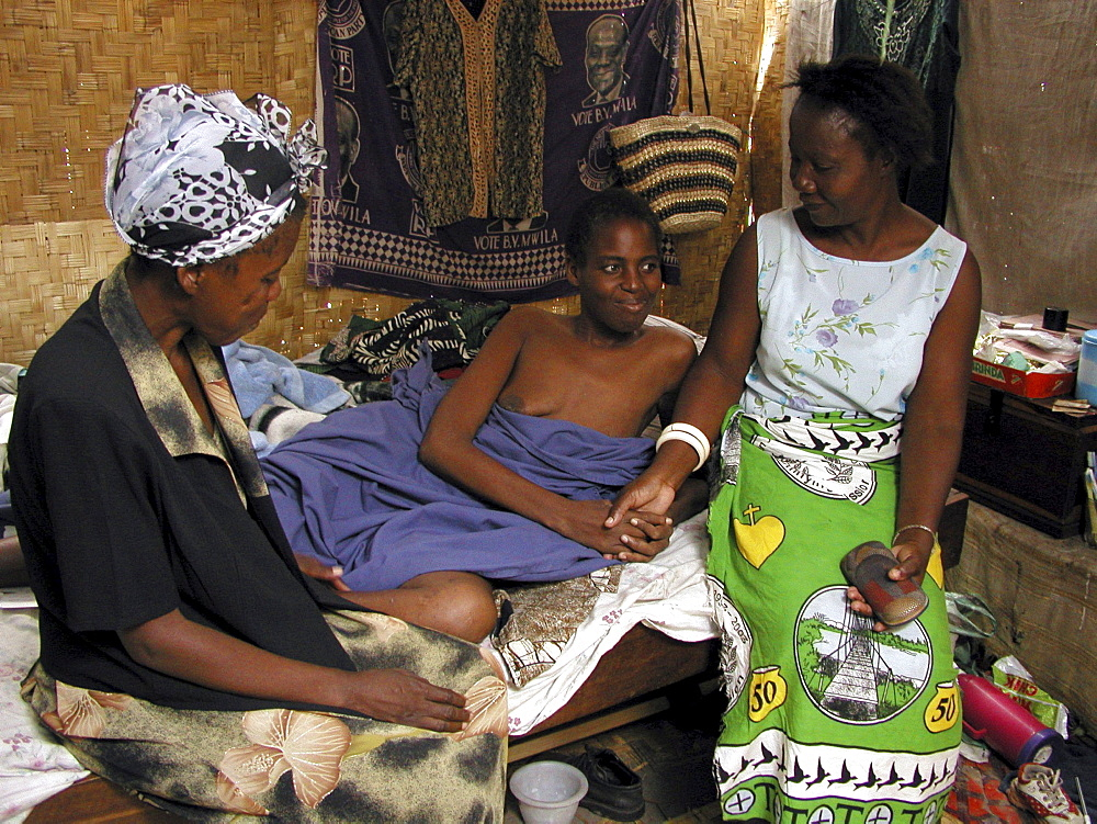 Zambia care giver visiting a woman who is hiv+, mongu