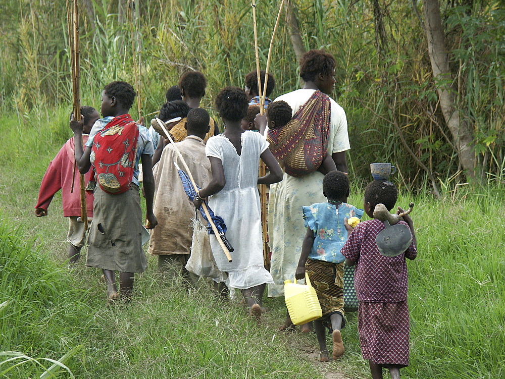 Zambia women and children walking to a lake for fishing