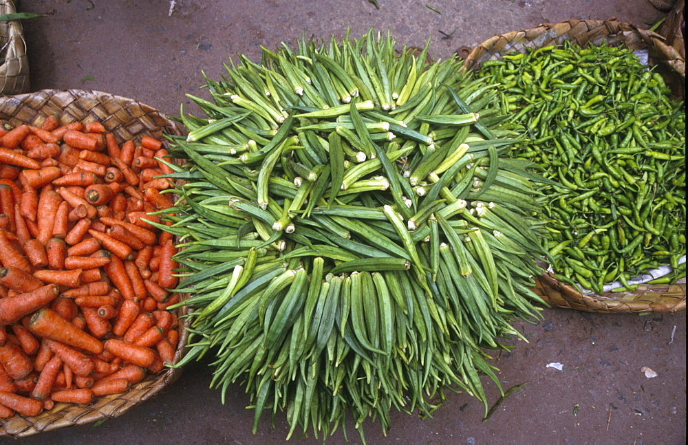 India - food: carrots, ladies fingers and chilis on sale, vegetable market, trivandrum, kerala