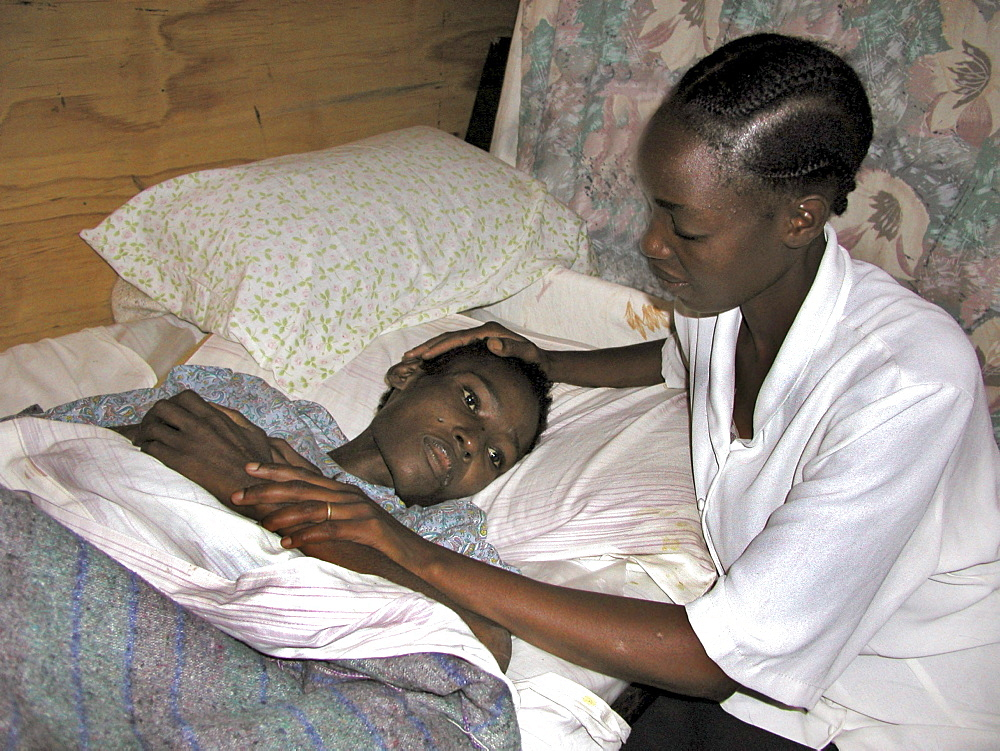 Kenya catholic lay missionary visiting woman. Korogocha, nairobi
