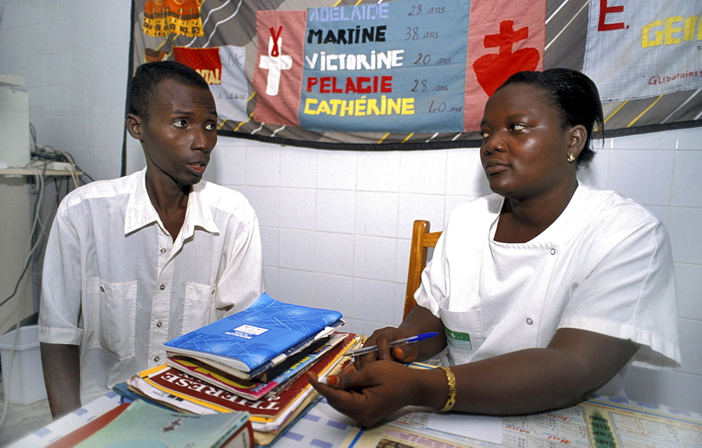 Benin atimakan vincent de, (40), hiv+ receiving counselling. I no how i caught, maybe a mosquito, i never slept anyone but my Saint camille clinic, abomey.