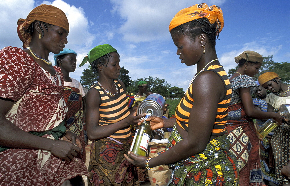 Benin women at crs distribution after a mother/ clinic hangar village, bembereke