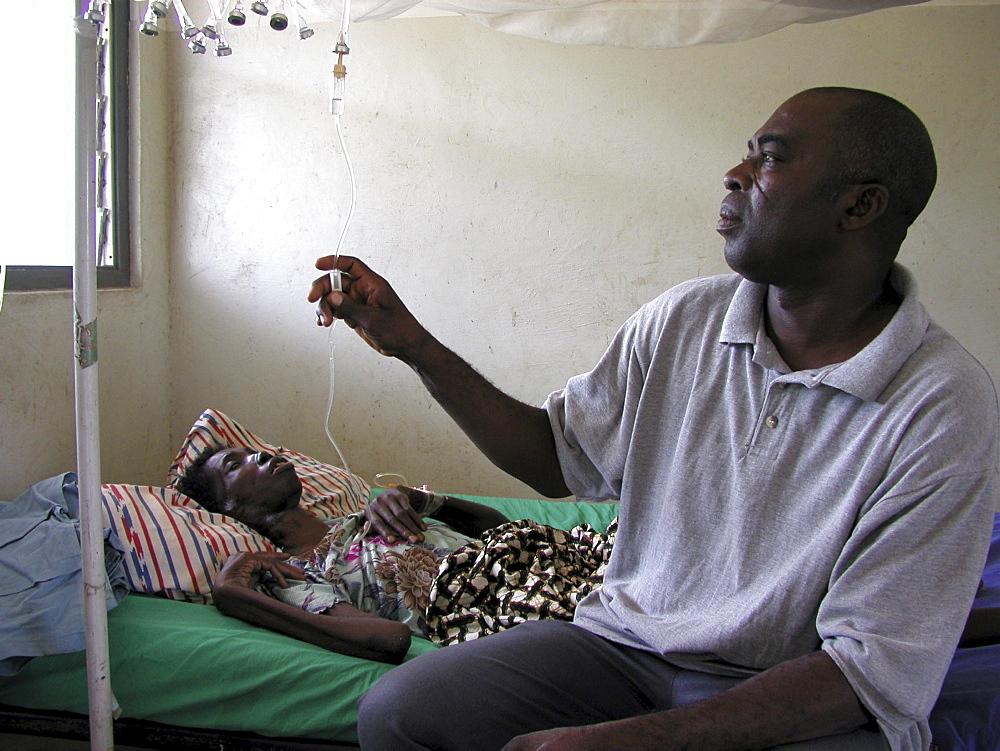 Ghana idi adama (), nurse visiting abiba zakariah who is blind and hiv+ at sheikhanah clinic, tamale