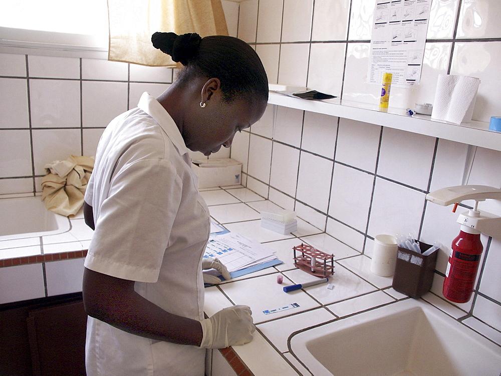 Senegal lab techniciane maria ndour testing blood samples for hiv virus service cnter, dakar