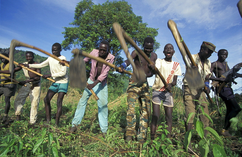 South sudan soldiers cultivating field chukudum