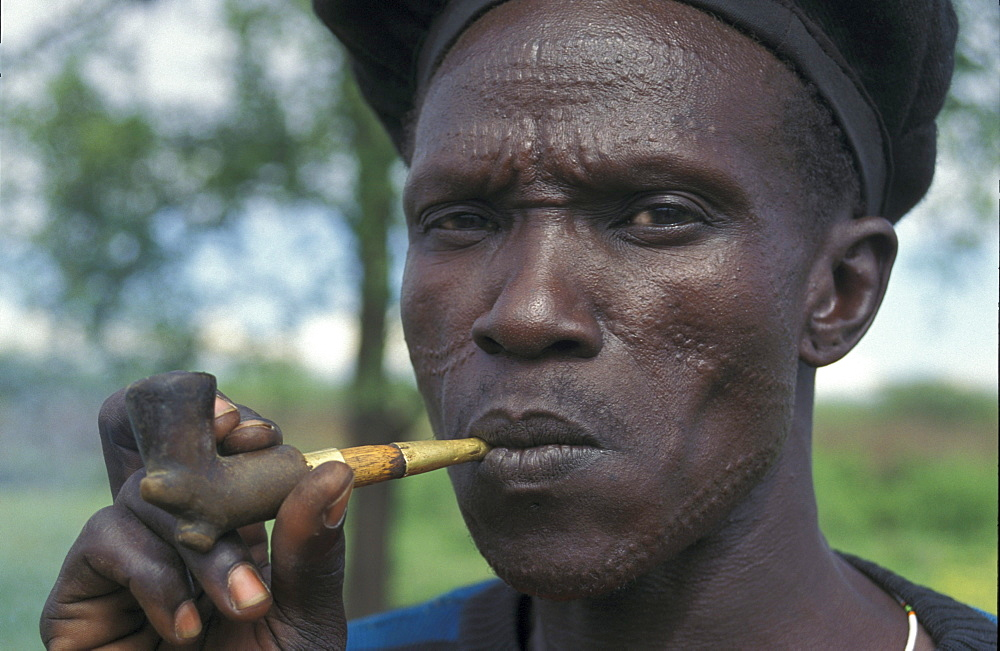 South sudan toposa man smoking a, narus