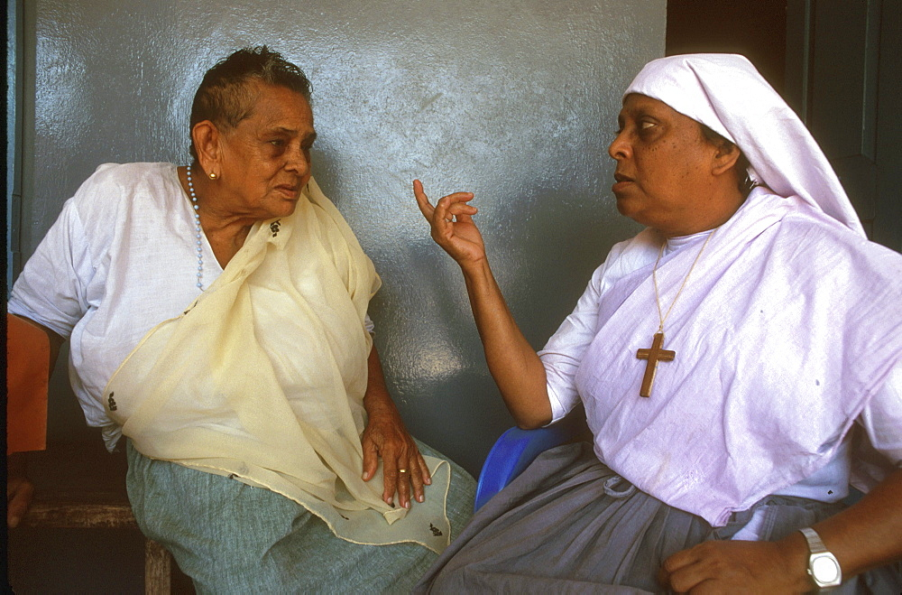 India catholic talking to woman at old peoples, trichur, kerala