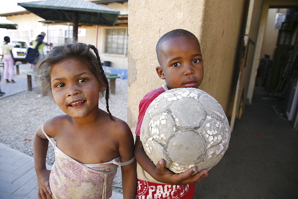Namibiachildren, many of whom aids orphans positive themselves at bernard nordkamp (youth) center,katatura, a black township of windhoek, (dating from apartheid). With football.