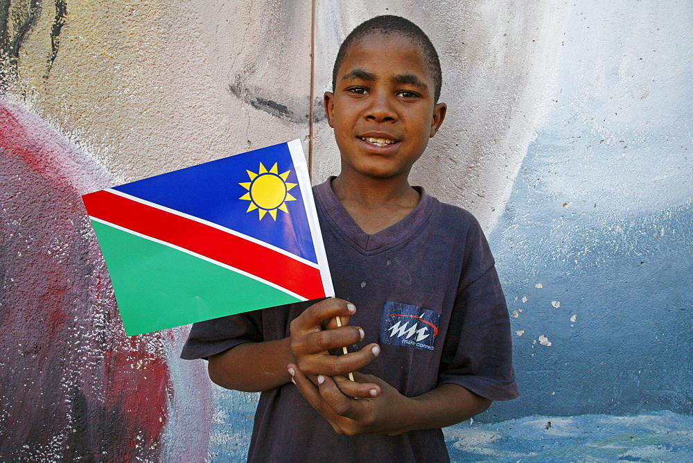 Namibia child holding national flag at bernard nordkamp (youth) center, katatura, a black township of windhoek, dating from apartheid