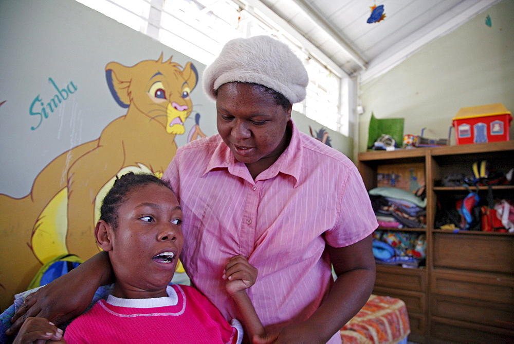 Namibia oranganda community centre, windhoek. A place which looks after children with severe disabilities. Director of centre with an 18-year- girl with ms. maryknoll