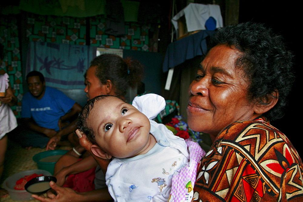 Fiji grandmother and baby, qeleni village, taveuni photo by sean sprague - 1194-2196