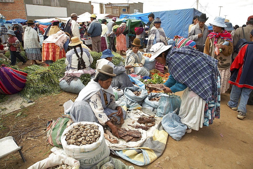 Bolivia. Aymara women selling potatoes and other vegetables at a street market in el alto