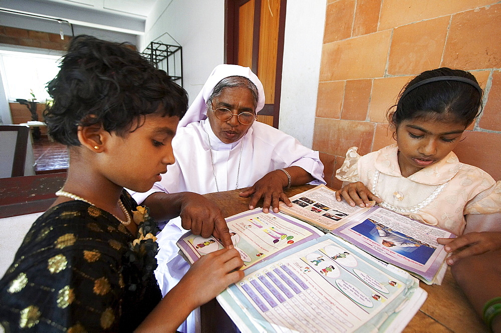 India. Study and reading time, helped by sister jane thennattil (director).Mary Matha bala bhavan, a girls orphanage run by syro-malabar catholic missionary sisters of mary immaculate (msmi), chamal village, thamarassery diocese, khozikode, kerala. 2007