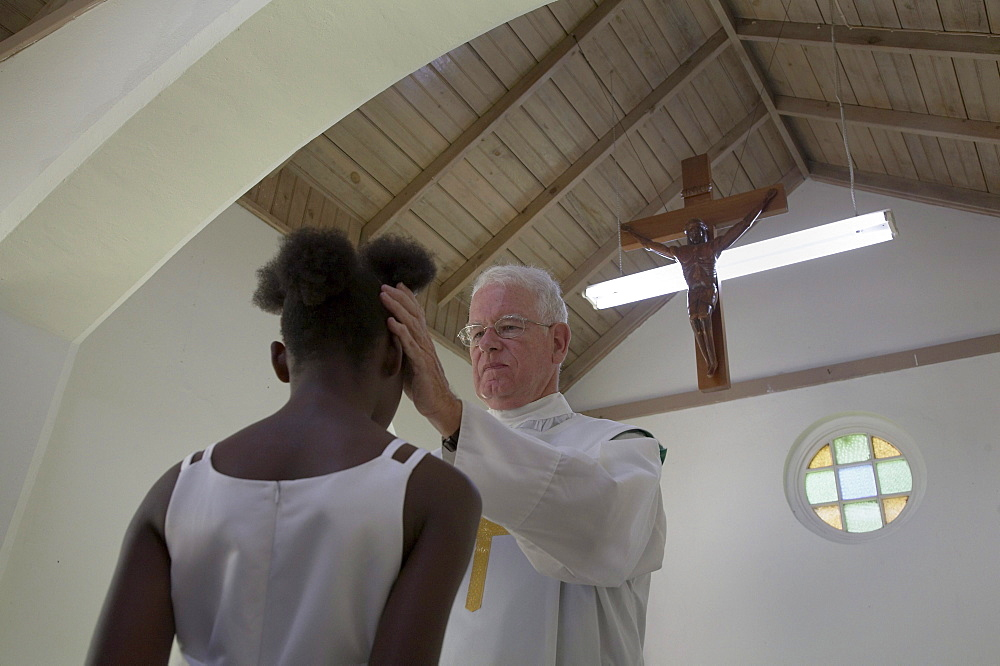 Jamaica. American priest celebrating sunday mass at catholic church in chester castle