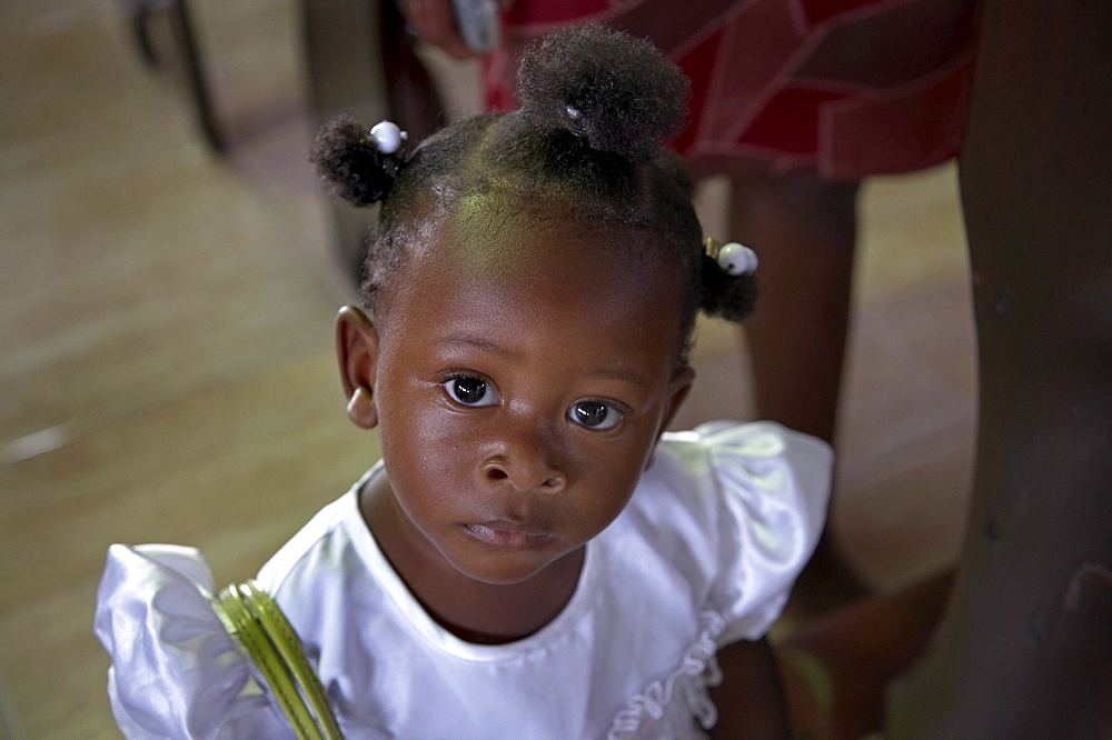 Jamaica. Girl at sunday mass in the catholic church at seaford town