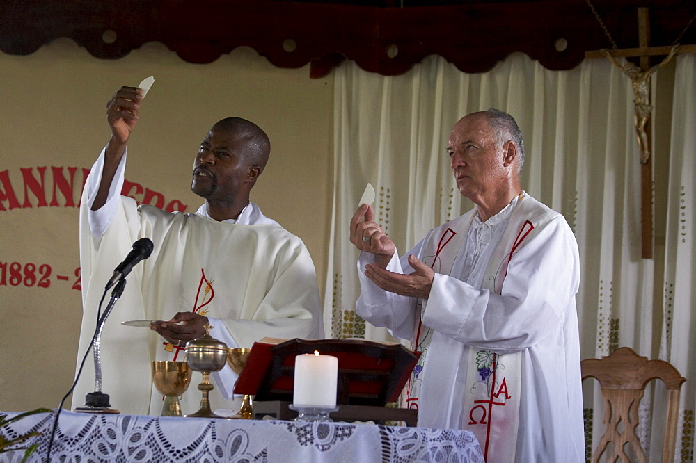 Jamaica. Priests con celebrating at sunday mass in the catholic church at seaford town
