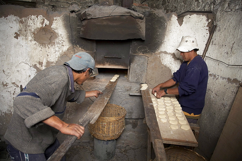 Peru. Making bread on wood fired oven, colca canyon - 1194-2394