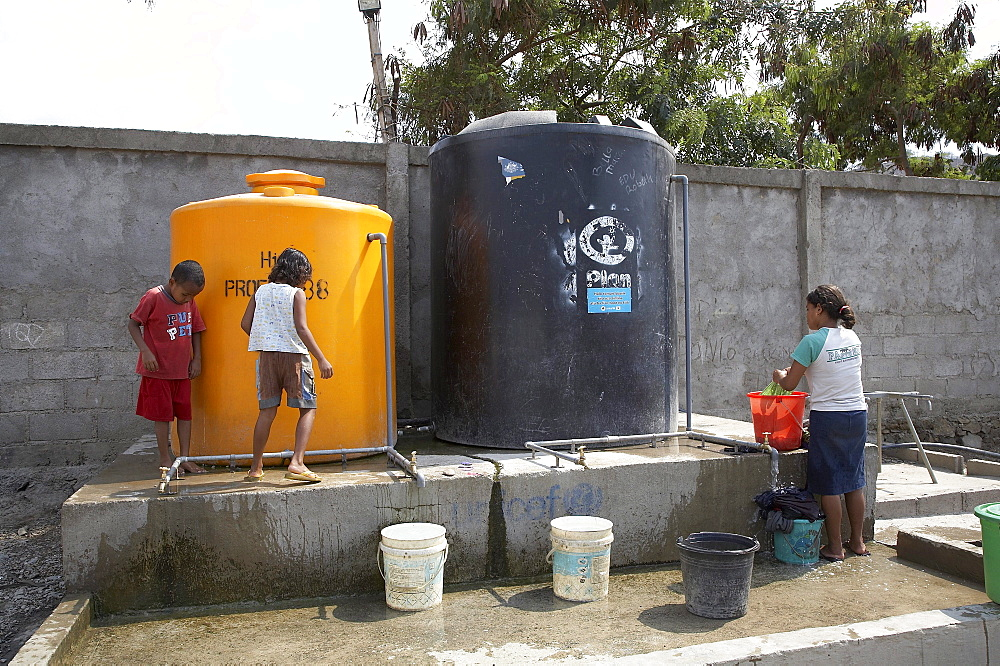 East timor. Camp for internally displaced people (idps) at the don bosco center in dili. Water tanks