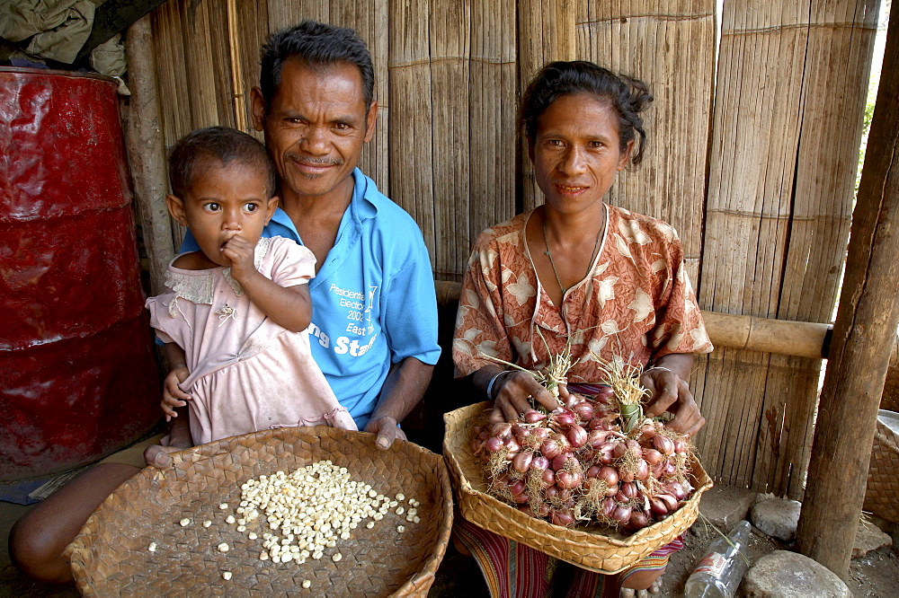 East timor. Husband and wife with maize seeds and onions which they will plant next year, oecussi-ambeno
