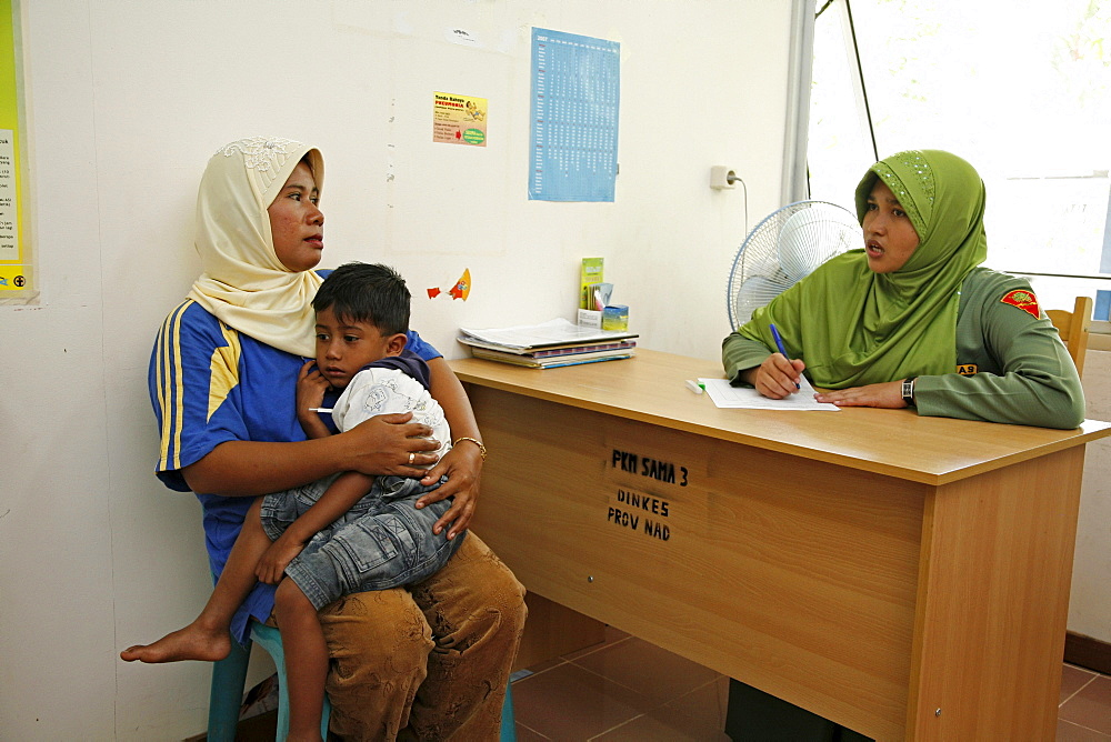Indonesia government health clinic (pos kesmas) at cot seumereng, desa pucoh leung. mother with sick child come for consultation. meulaboh, aceh - 1194-2464