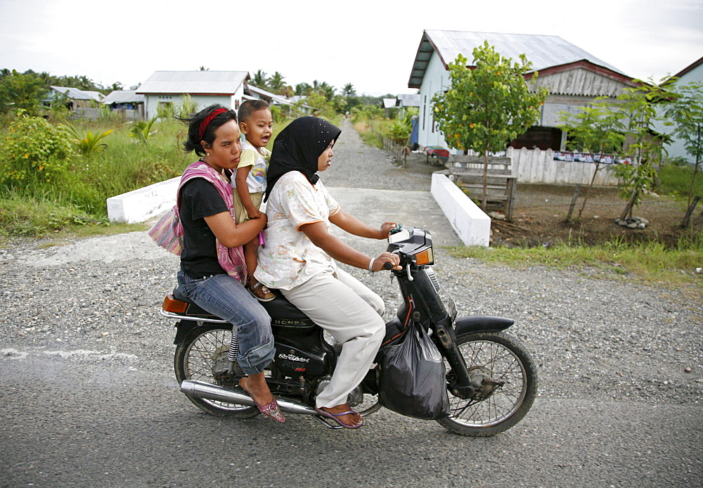 Indonesia transport by motor-cycle, meulaboh, aceh, two years after the tsunami