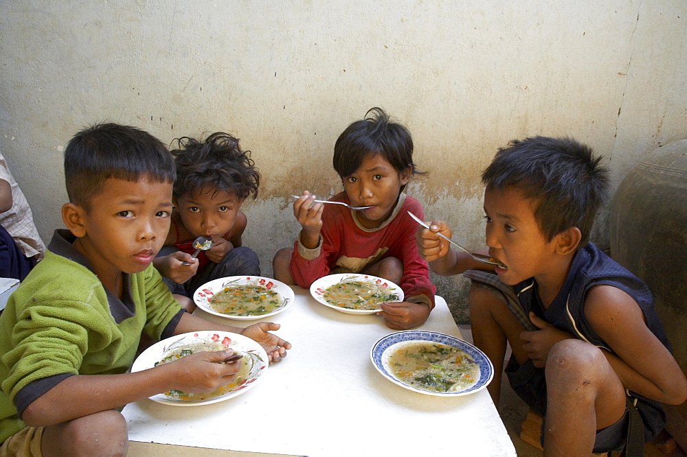 Cambodia lunch time at the childrens center in anlon kgnan