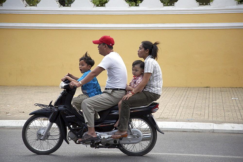 Cambodia family on motor cycle. phnom penh