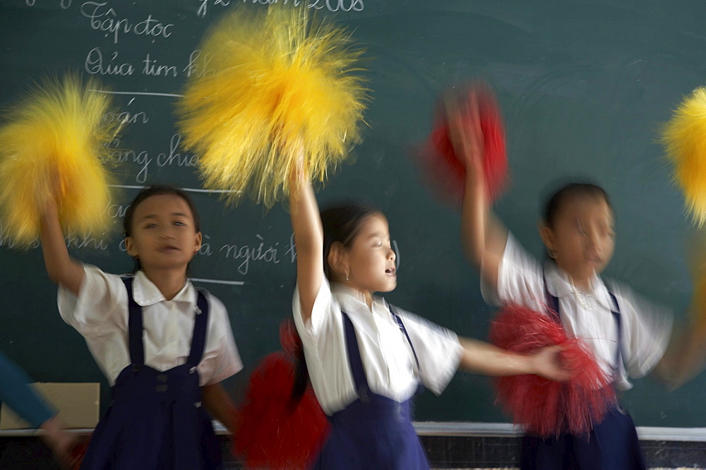 Vietnam hoa binh primary school in vinh long province. children in school practice cheerleading