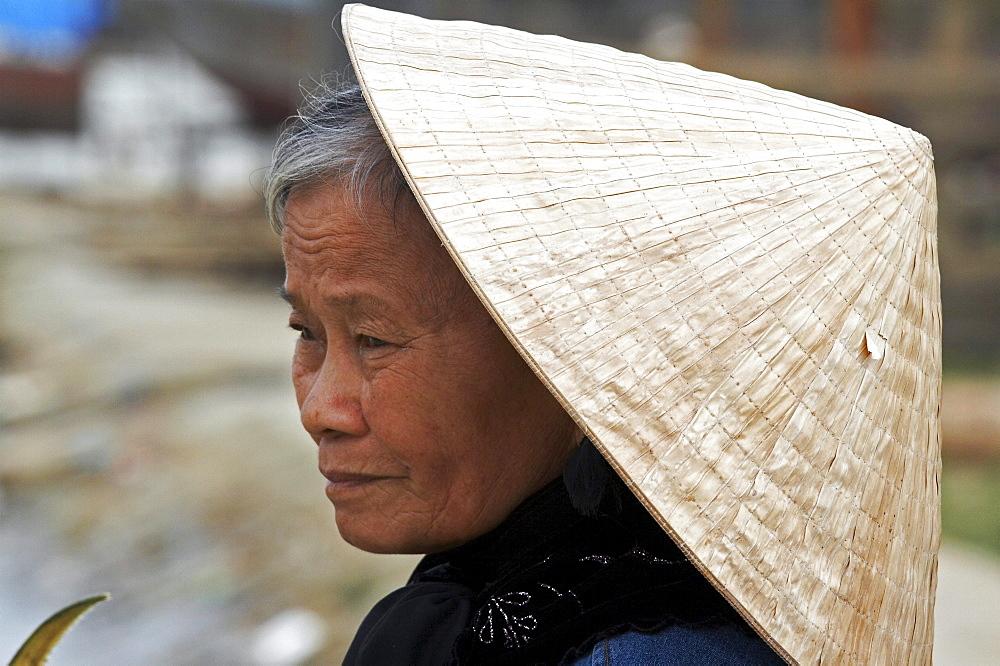 Vietnam woman wearing traditional hat, hoi an