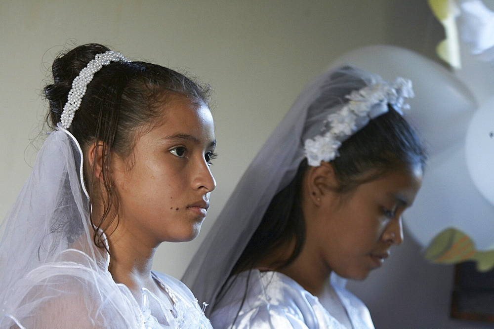 Guatemala catholic first communion and mass at remate, el peten. girls during mass