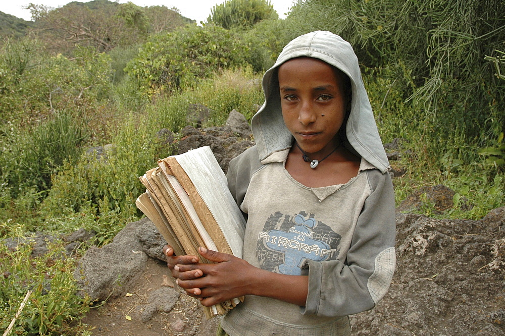Child, ethiopia. Tullo gudo island and its monastery of debre zion, lake ziway. Girl walking to school carrying her books