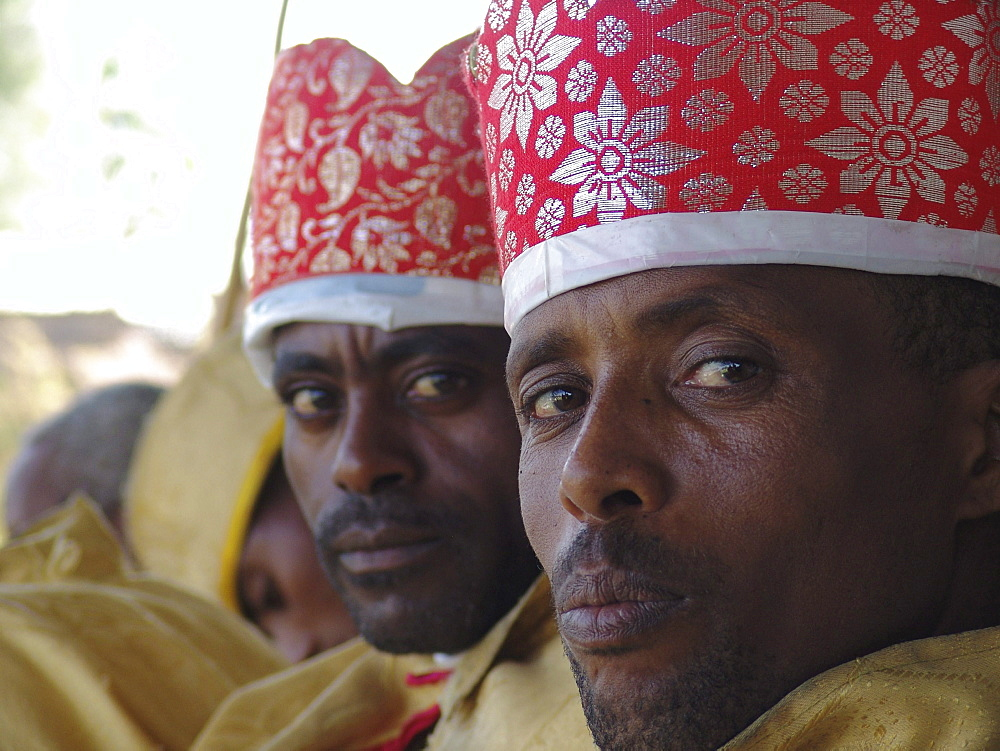 Religion, ethiopia. Debre zeyit orthodox church, kuifto village. Deacons of the church dressed in yellow robes and red or yellow caps, on attendance during sunday mass