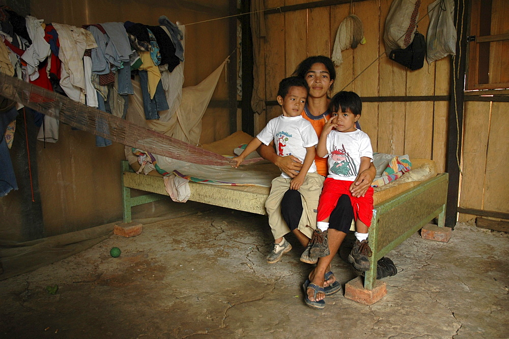 Colombia very poor mother with her two sons, barrancabermeja