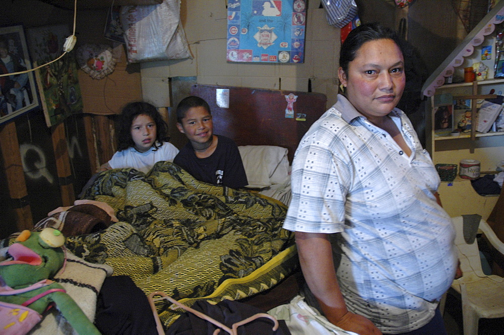Colombia woman and her children at home in altos de cazuca, bogota